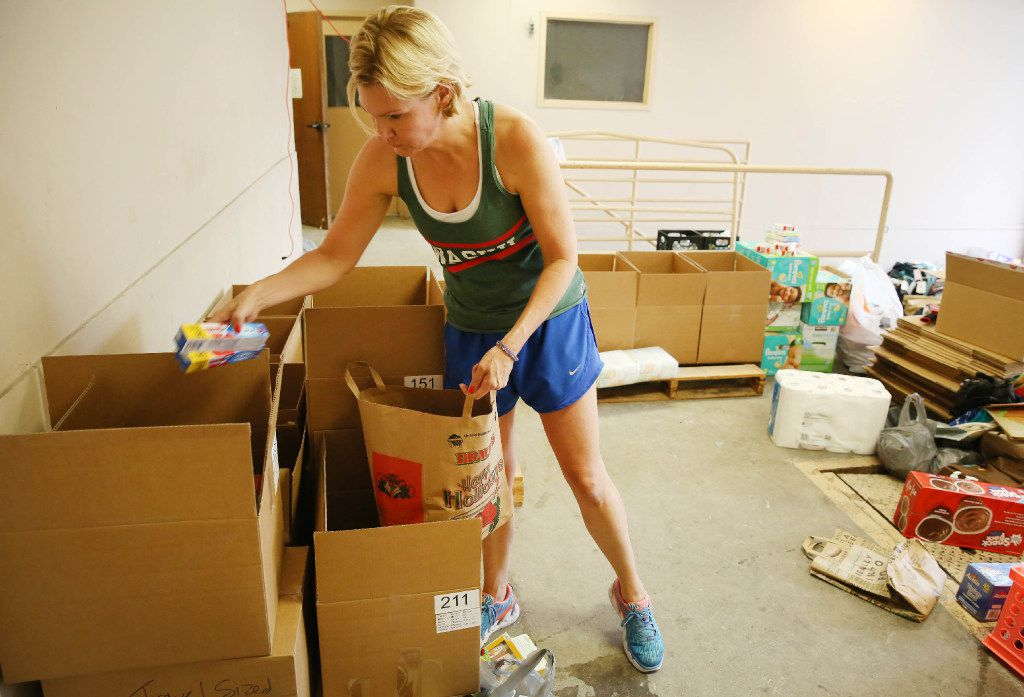 Volunteer Rebecca Wilson organize donations at a drop off location of Trusted World donations for Hurricane Harvey relief in Dallas Sunday August 27, 2017.