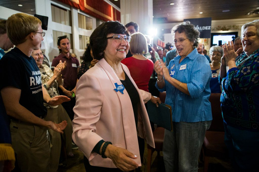 Gubernatorial candidate and former Dallas County Sheriff Lupe Valdez made her way to a podium after her runoff win at a Democratic party celebration at Ellen's in Dallas.