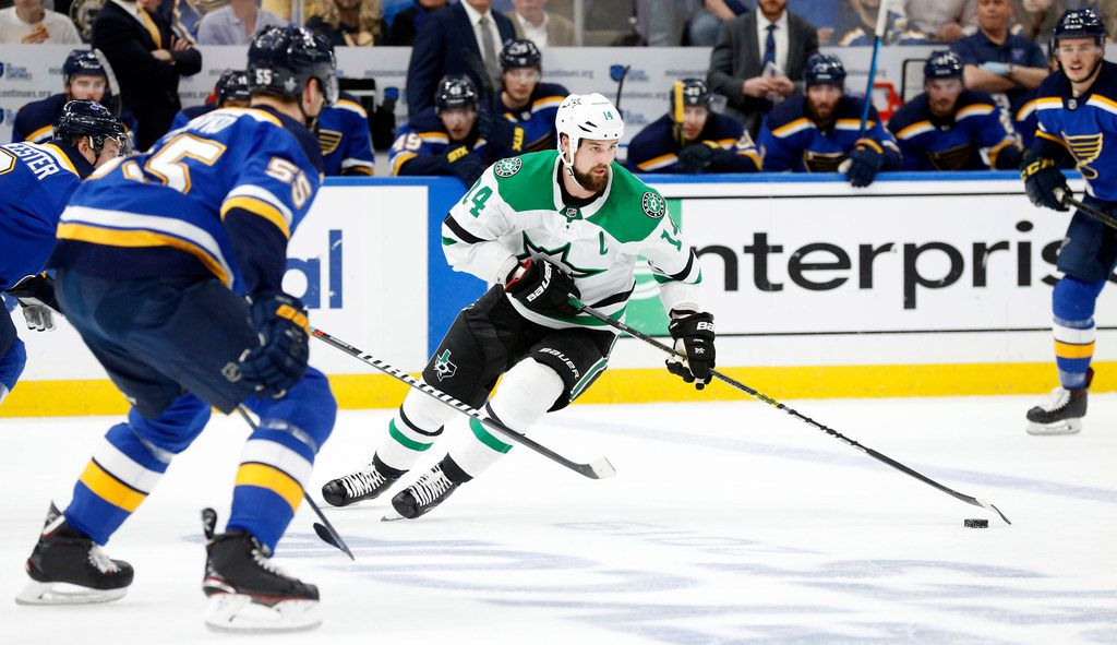 FILE - Dallas Stars left wing Jamie Benn (14) controls the puck against the St. Louis Blues during the first period at the Enterprise Center in St. Louis, Tuesday, May 7, 2019. The teams were playing in the Western Conference Second Round Game 7 of the 2019 NHL Stanley Cup Playoffs.