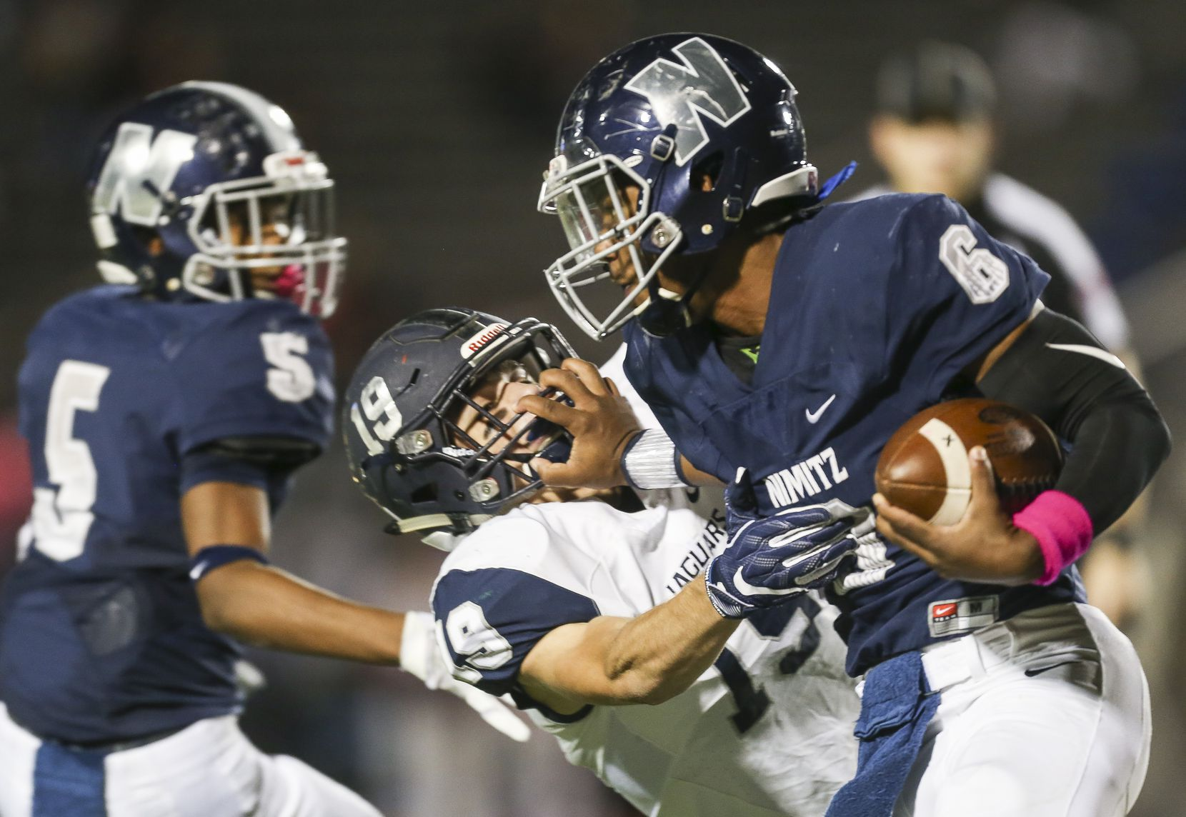 Nimitz running back Christian Nelms (6) breaks past Flower Mound safety Zach Compton (19) during a matchup between Nimitz and Flower Mound on Thursday, Oct. 11, 2018 in Irving, Texas. (Ryan Michalesko/The Dallas Morning News)