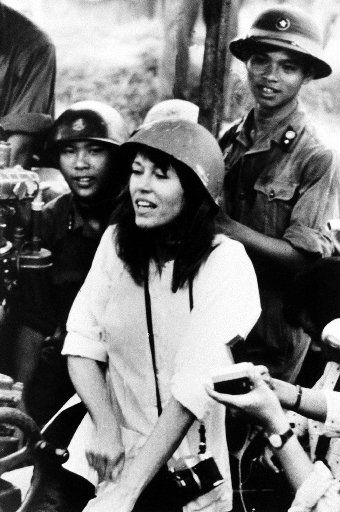 In this July 1972 file photo, American actress and activist Jane Fonda is surrounded by soldiers and reporters as she sings an anti-war song near Hanoi during the Vietnam War.