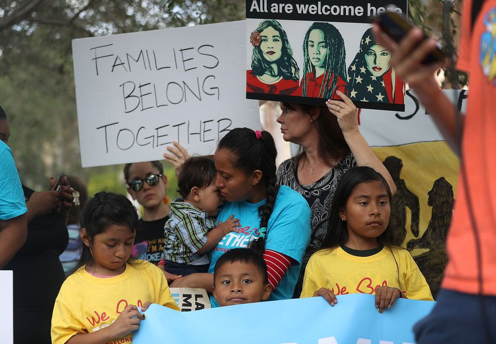 Protesters join together during a rally in front of the Miramar ICE detention facility on the National Day of Action for Children on June 1, 2018 in Miramar, Fla. The day of action was held to ask the Trump administration to keep families together as they seek legal status in the U.S.  (Photo by Joe Raedle/Getty Images)