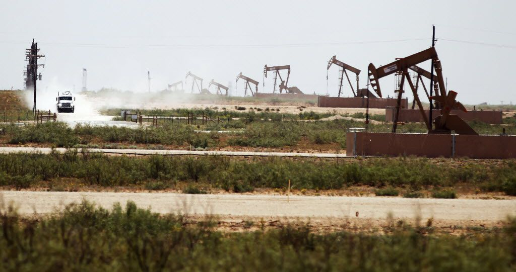 Oil pumps work tirelessly on land owned by Fasken Oil and Ranch near Midland.