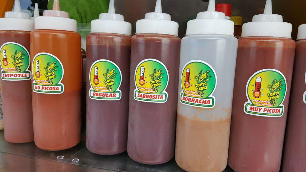 Various sauces on display at Elotes Fanny in Dallas.