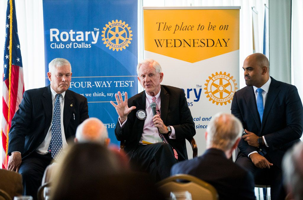 Congressional candidate Pete Sessions, left, debates Colin Allred, right, at a Rotary Club of Dallas lunch on Wednesday, September 19, 2018 at The City Club in downtown Dallas. Moderator Dennis McCuistion is at center. (Ashley Landis/The Dallas Morning News)