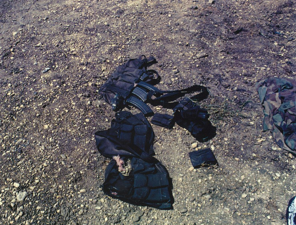 A FBI Hostage Rescue Team photo of ammunition vests and weapons that a survivor removed after fleeing the burning compound. (FBI photo)