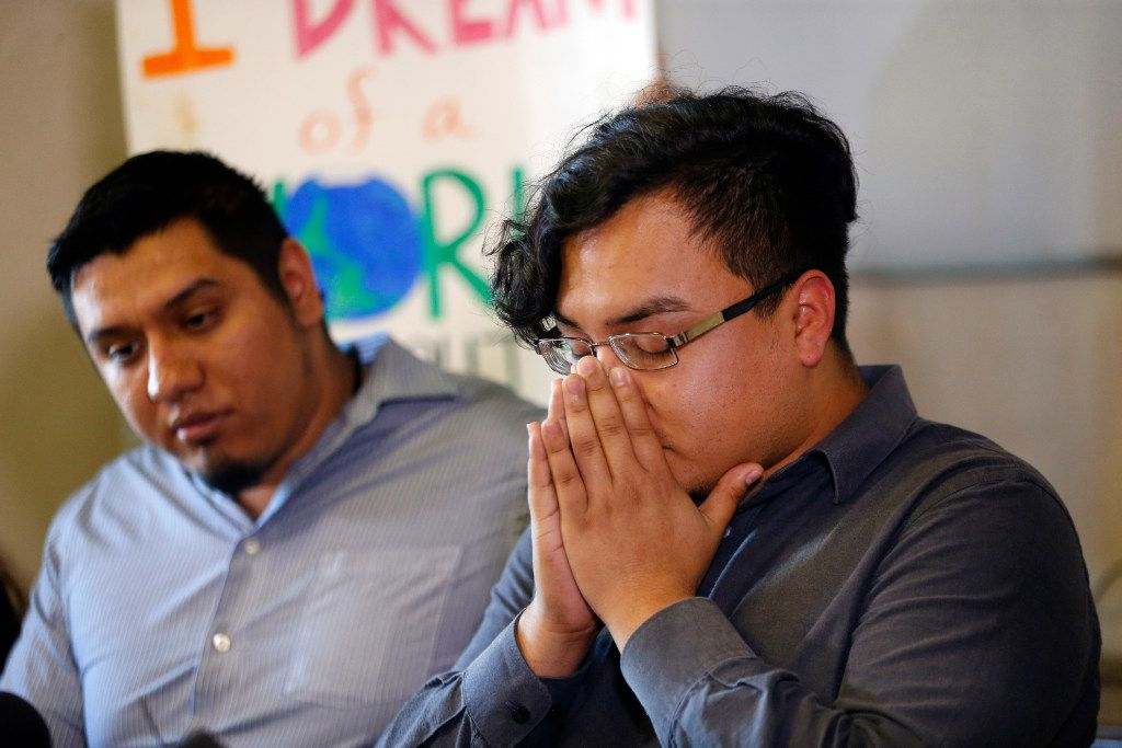Edwin Romero, a Mexican immigrant detained by Richardson police and then freed, closes his eyes during a news conference on Wednesday. At his side, on the left, is his friend Abraham Ponce. (Tom Fox/The Dallas Morning News)