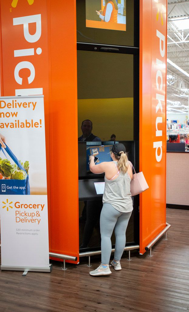 Mackenzie McDaniel of Keller picks up a pair of packages at a North Richland Hills Walmart on April 5, 2019.