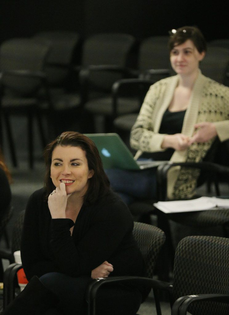 Ashley H. White (left), co-founder and co-artistic director of Imprint Theatreworks, watches during a rehearsal of Glengarry Glen Ross at the Bath House Cultural Center in Dallas on Dec. 4, 2017.