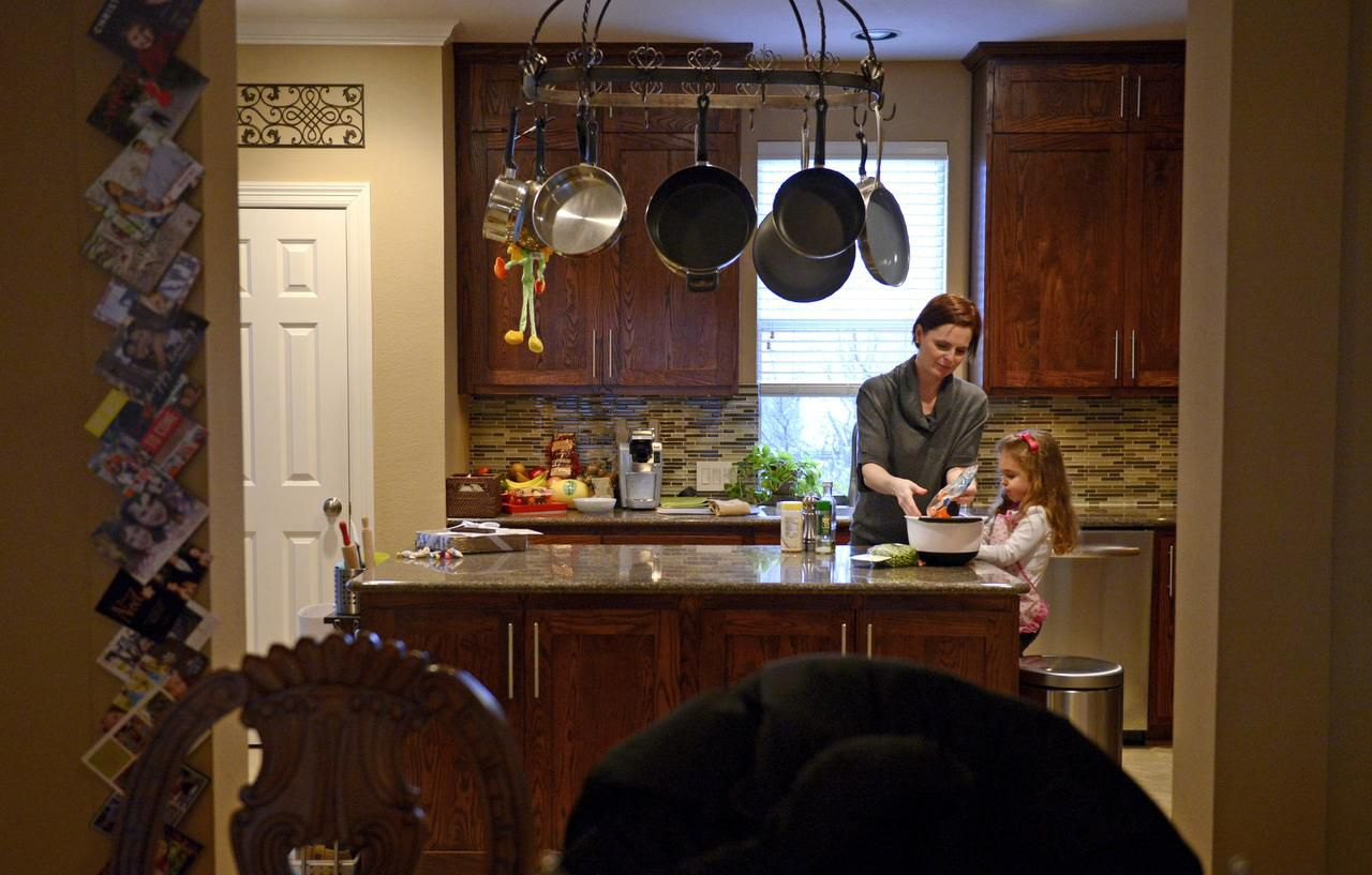 """Danika Mendrygal makes dinner with daughter McKenna, 3, at their Uptown townhome. """"Our lives are so much more convenient and so much fuller because of the neighborhood we live in,"""" Mendrygal said. """"And her life is fuller, too."""""""