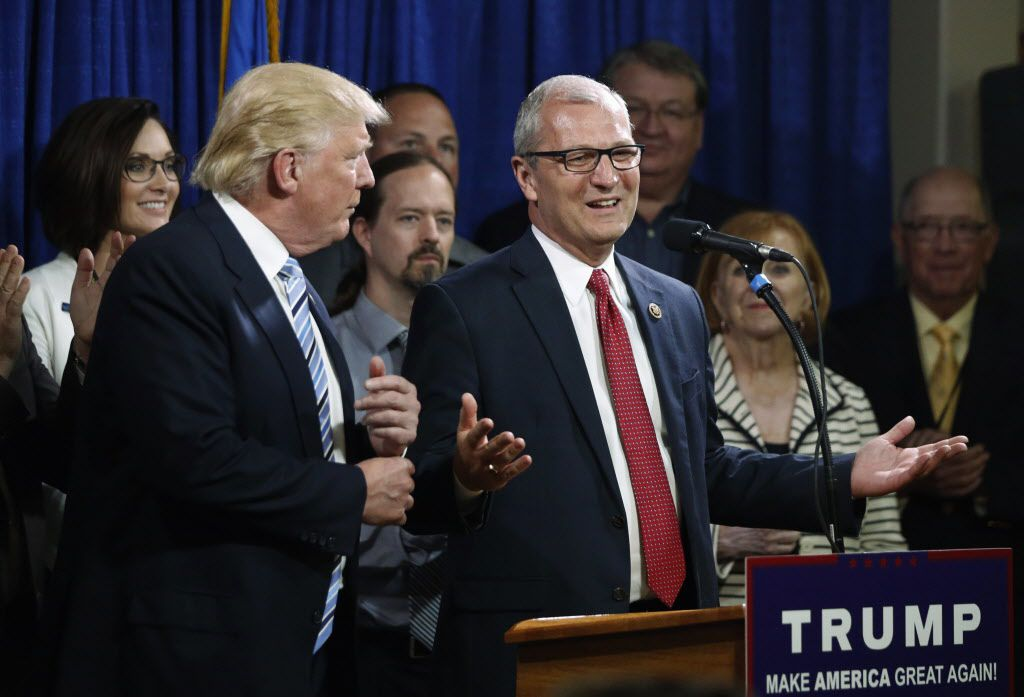 FILE - In this May 26, 2016 file photo, U.S. Rep. Kevin Cramer, R-N.D., right, talks about being one of the first to endorse then Republican presidential candidate Donald Trump during the North Dakota Republican National Convention in Bismarck.(AP Photo/Charles Rex Arbogast, File)