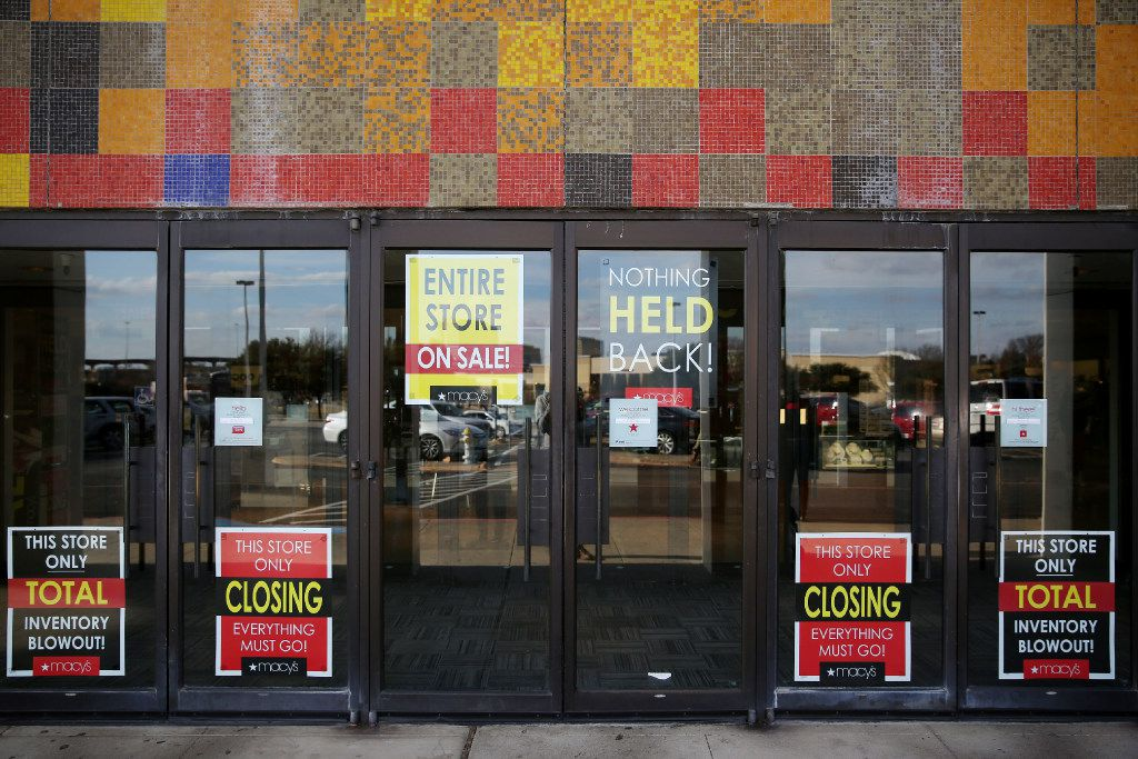 Closing signs on the door of Macy's at Collin Creek Mall in Plano, Texas Monday January 1, 2017. The mall is losing its Macy's store, and redevelopment of the land is being considered.