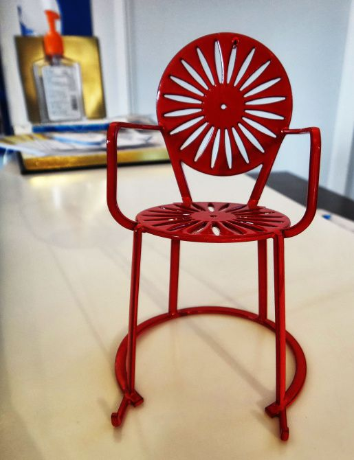 The stamped-metal sunburst chairs are a decades-old icon of University of Wisconsin's Memorial Union Terrace. The Terrace store sells full-size and miniature versions of the popular design.