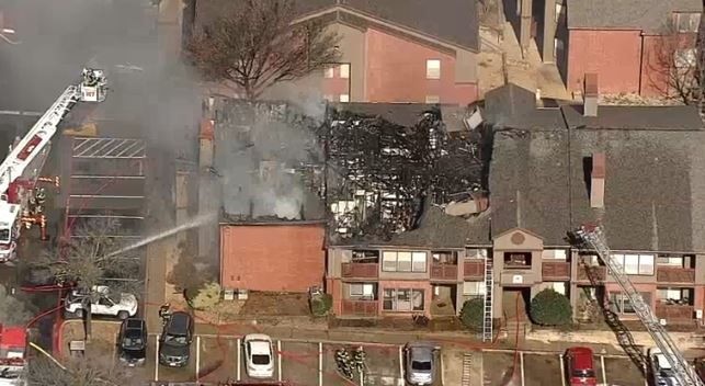 Firefighters battle a fire at a Lewisville apartment complex Tuesday morning. Smoke was visible for miles, according to KXAS-TV (Channel 5).