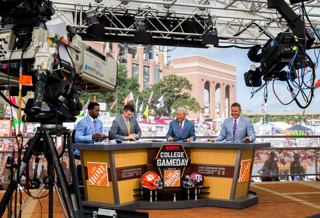 The ESPN College GameDay crew laughs during a broadcast before the Texas A&M Aggies took on the Clemson Tigers on Saturday, September 8, 2018 outside Kyle Field in College Station, Texas.