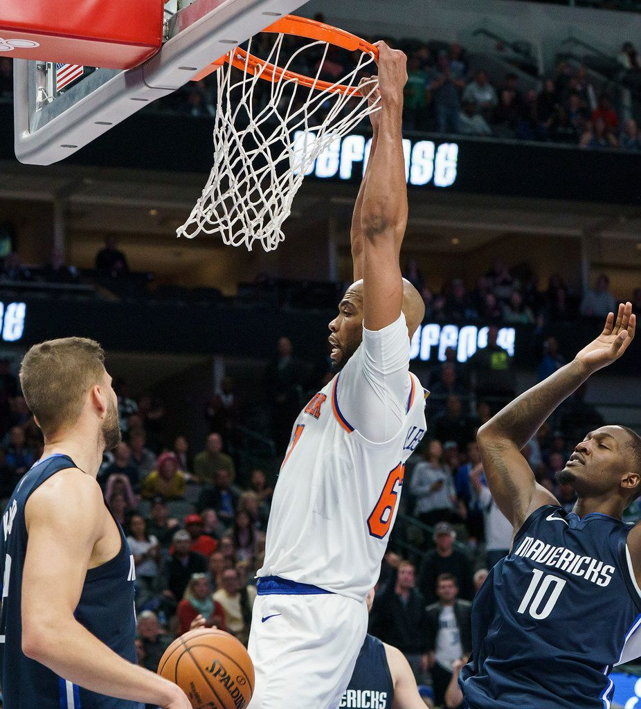 New York Knicks forward Taj Gibson (67) dunks the ball past Dallas Mavericks forward Dorian Finney-Smith (10) and center Maxi Kleber (42) during the second half of an NBA basketball game at American Airlines Center on Friday, Nov. 8, 2019, in Dallas. (Smiley N. Pool/The Dallas Morning News)