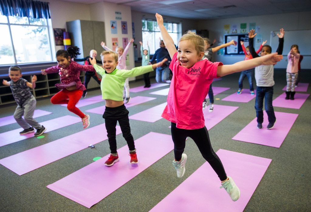 It wasn't all sitting and breathing for Charlotte Mayer (right) and her yoga-learning classmates.