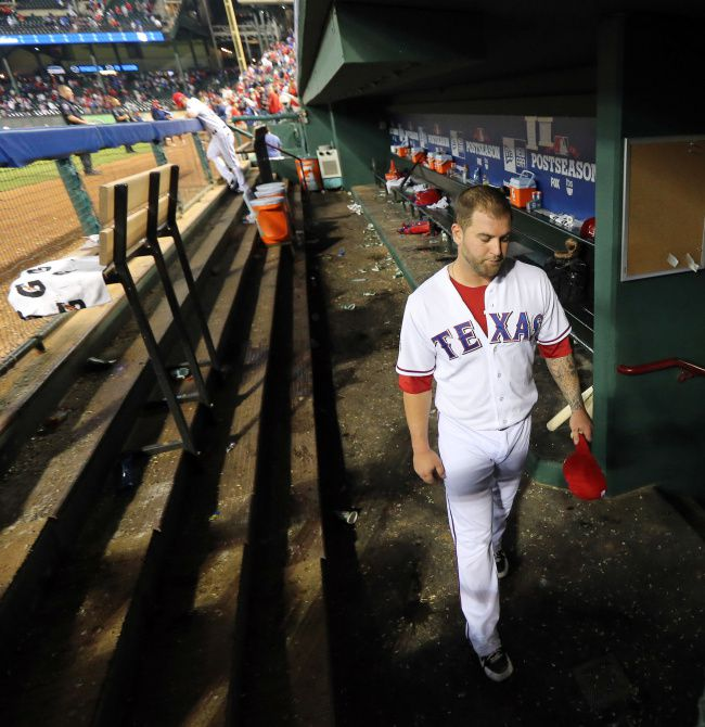 Texas catcher Mike Napoli leaves the dugout long after the rest of his teammates at the end of the Rangers' 5-1 loss during their American League wild card playoff MLB baseball game at Rangers Ballpark in Arlington on October 5, 2012.