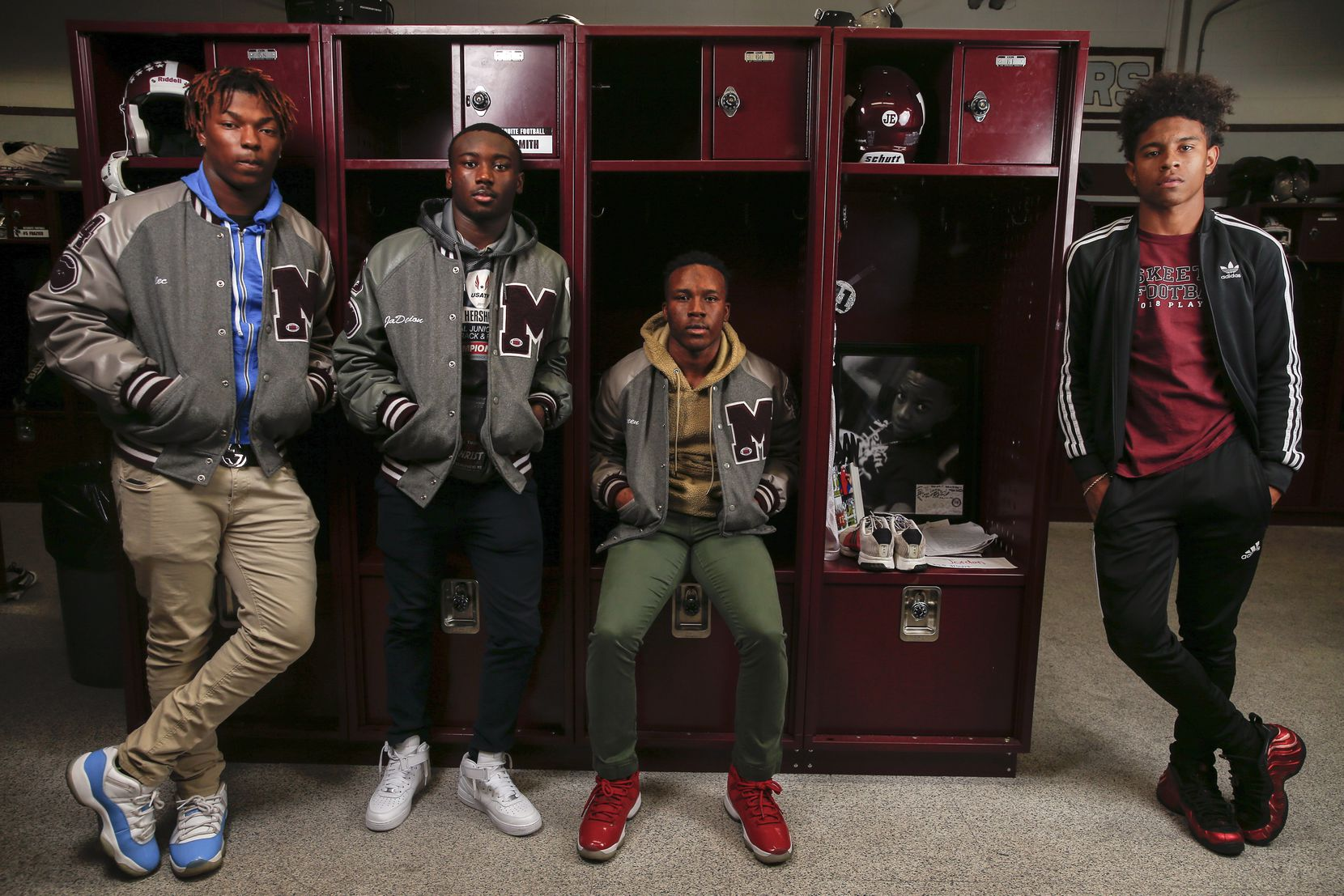 Senior Mesquite football players Alec Rice, left, Ja'Darion Smith, Gary Green, and De'Wayne Adams pose for a photograph next to the locker of their former classmate and Mesquite football player Jordan Edwards, on Thursday, Oct. 31, 2019 in Mesquite, Texas. Edwards would have been a senior member of the Mesquite football team this year. Instead, he was murdered by a Balch Springs police officer two years ago. Students have made the locker a permanent reminder Edwards, leaving behind notes, momentos, and decorating for homecoming. (Ryan Michalesko/The Dallas Morning News)