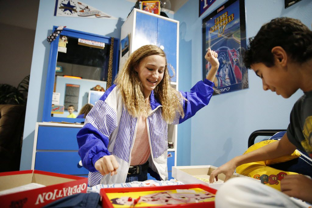 """Kennedy Kellen, 14, cheers while playing """"Operation"""" with Adrian Rivera, 13, both of Frisco, during the soft opening of the National Videogame Museum at the Frisco Discovery Center in Frisco on March 26, 2016. (Andy Jacobsohn/The Dallas Morning News)"""