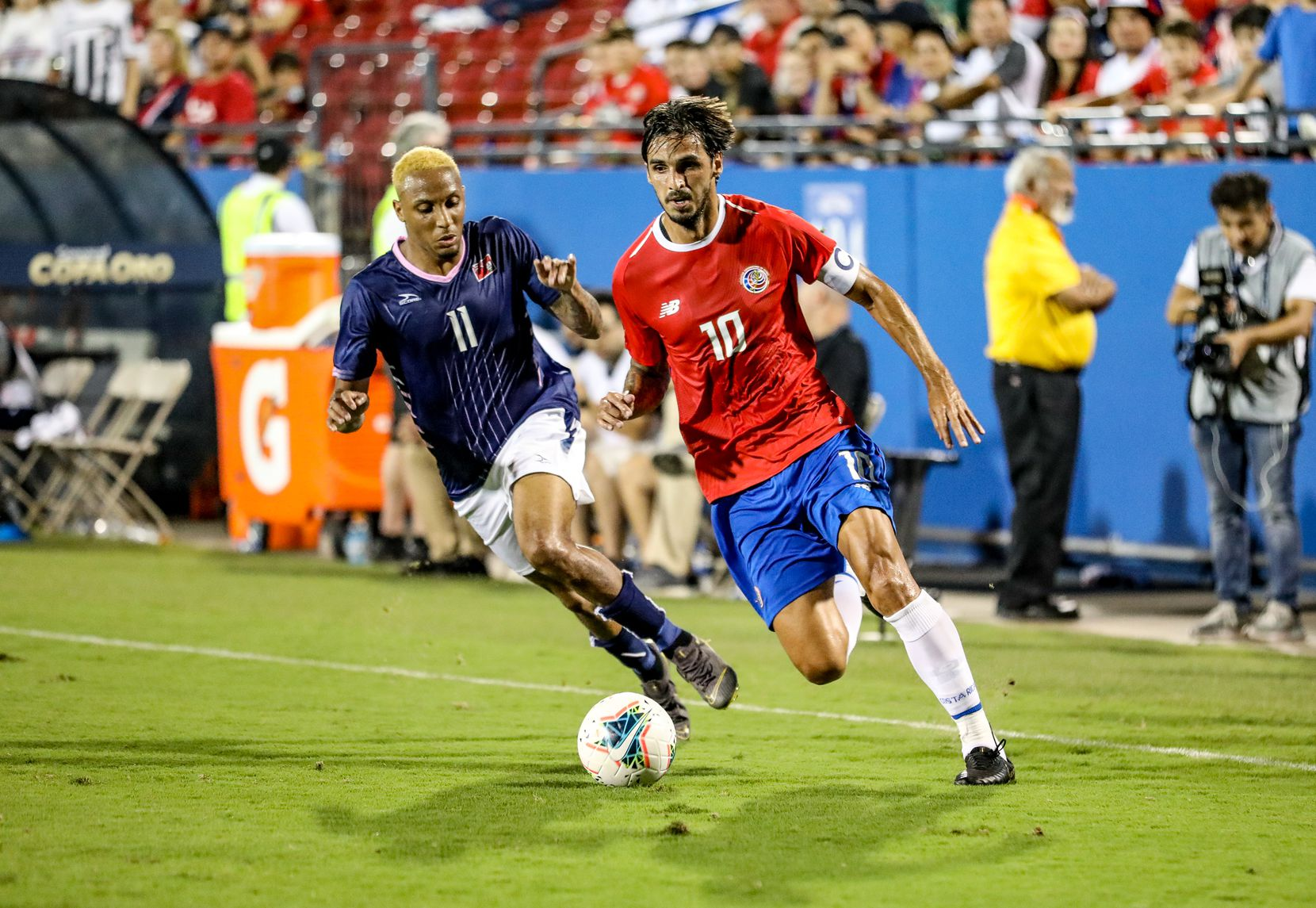 Bryan Ruiz of Costa Rica is chased by Bermuda's Willie Clemons during the 2019 Gold Cup at Toyota Stadium. (6-20-19)