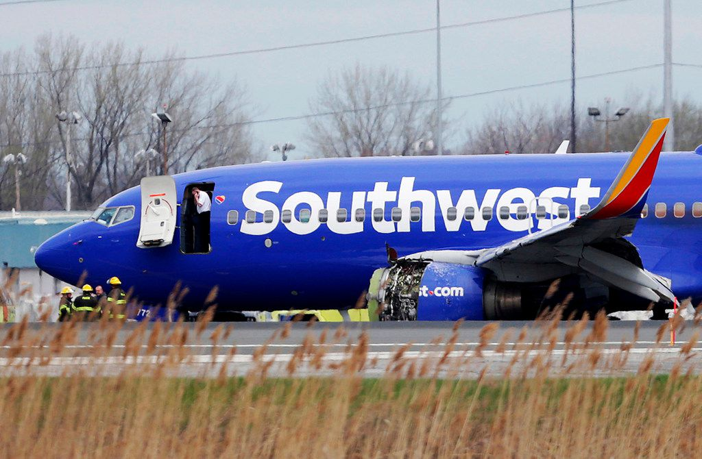 A Southwest Airlines plane sits on the runway at Philadelphia International Airport after it made an emergency landing Tuesday.