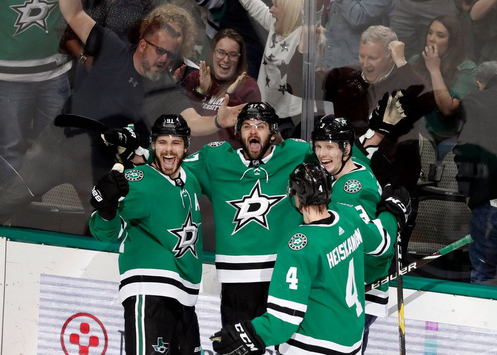 Dallas Stars' Tyler Seguin, from left, Alexander Radulov, John Klingberg and Miro Heiskanen (4) celebrate after a score by Radulov in the third period of an NHL hockey game against the Florida Panthers in Dallas, Tuesday, March 19, 2019. Radulov scored two goals in the 4-2 Stars win. (AP Photo/Tony Gutierrez)