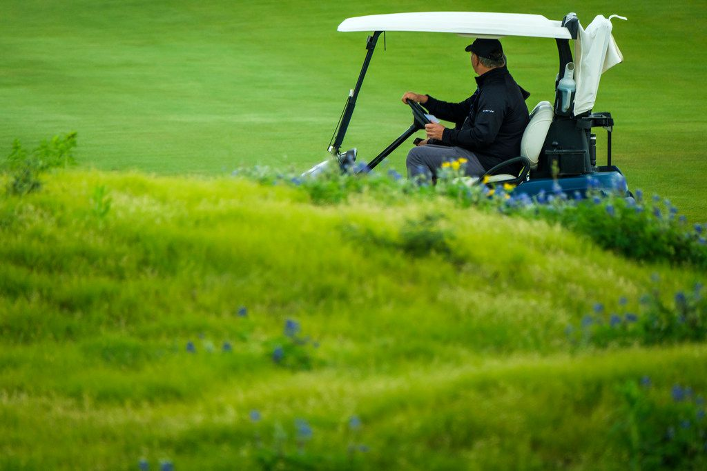 Dallas Mayor Mike Rawlings drives a golf cart to between fairways during the AT&T Byron Nelson golf tournament on Saturday, May 11, 2019, at Trinity Forest Golf Club in Dallas. (Smiley N. Pool/The Dallas Morning News)
