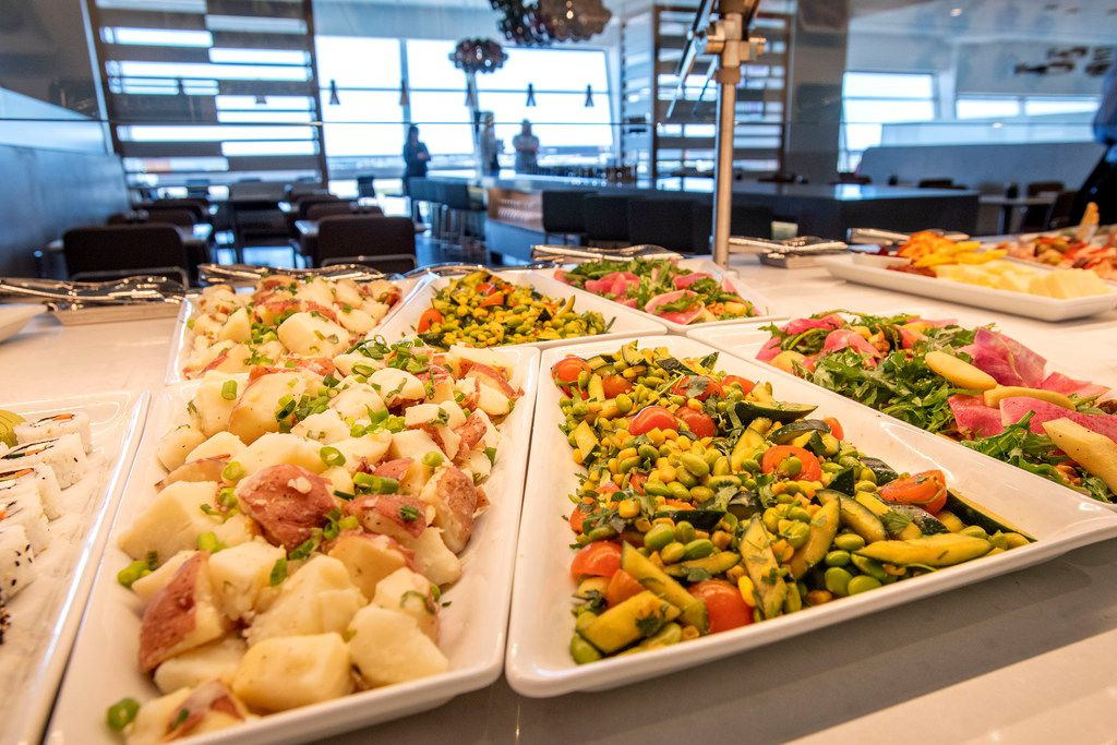 A cold buffet is displayed in the new American Airlines Flagship Lounge on Monday, May 13, 2019 in Terminal D at DFW Airport in Grapevine, Texas. (Jeffrey McWhorter/Special Contributor)