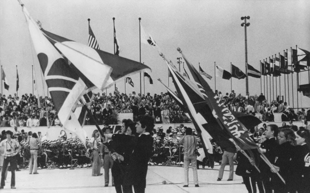 Flags of many countries were carried during dedication ceremonies for Dallas-Fort Worth International Airport in 1973.