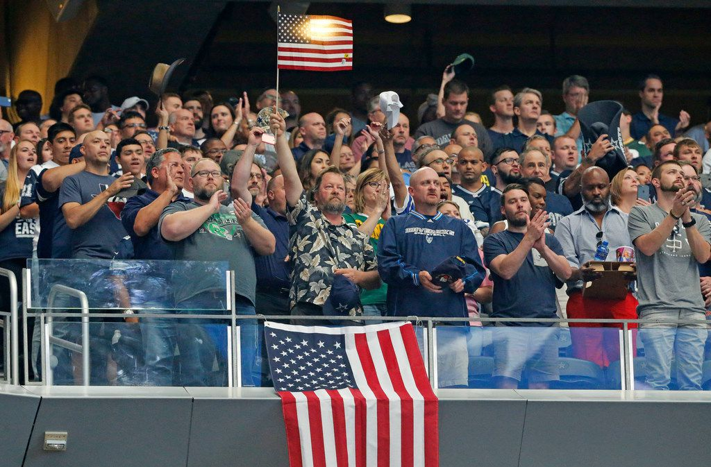Fans stand during the national anthem before the Green Bay Packers vs. the Dallas Cowboys NFL football game at AT&T Stadium in Arlington, Texas on Sunday, October 8, 2017. (Louis DeLuca/The Dallas Morning News)