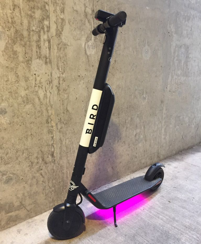 A Bird electric scooter shows its colors on Tuesday morning, Oct. 23, 2018, in Dallas. The electric scooter startup debuted its fleet in June.