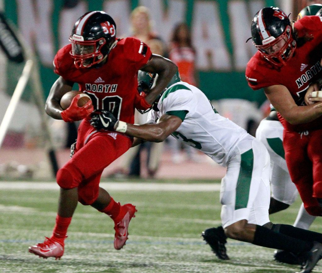 North Garland RB Sabron Woods (20) picks up a first down during the first half of the Garland Naaman Forest Vs. North Garland high school football game at Williams Stadium in Garland on Friday, October 4, 2019. (John F. Rhodes / Special Contributor)
