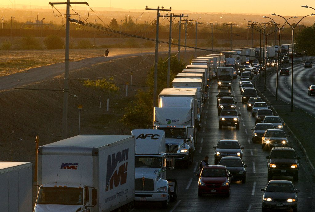 """Trucks wait to cross the border with the U.S. in Ciudad Juarez, Mexico, in April. President Donald Trump says he has """"indefinitely suspended"""" tariffs he has threatened to impose Monday on Mexican imports. Trump says on Twitter that the U.S. and Mexico """"reached a signed agreement"""" Friday, June 7, 2019 night. The president says Mexico """"has agreed to take strong measures to stem the tide of Migration through Mexico, and to our Southern Border."""""""