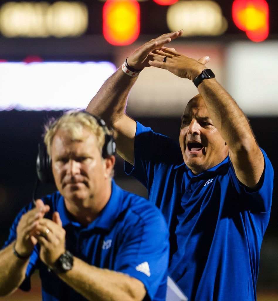 Hebron head coach Brian Brazil (right) calls for a timeout during the second half of a high school football game against Coppell on Friday, Oct. 4, 2019, in Coppell, Texas. (Smiley N. Pool/The Dallas Morning News)