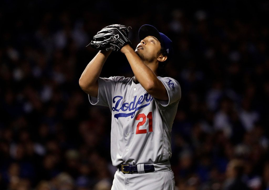 Los Angeles Dodgers starting pitcher Yu Darvish (21) looks up the sky as he exits in the seventh inning of Game 3 of the NLCS against the Chicago Cubs on Tuesday, Oct. 17, 2017, in Chicago. (AP Photo/Matt Slocum)