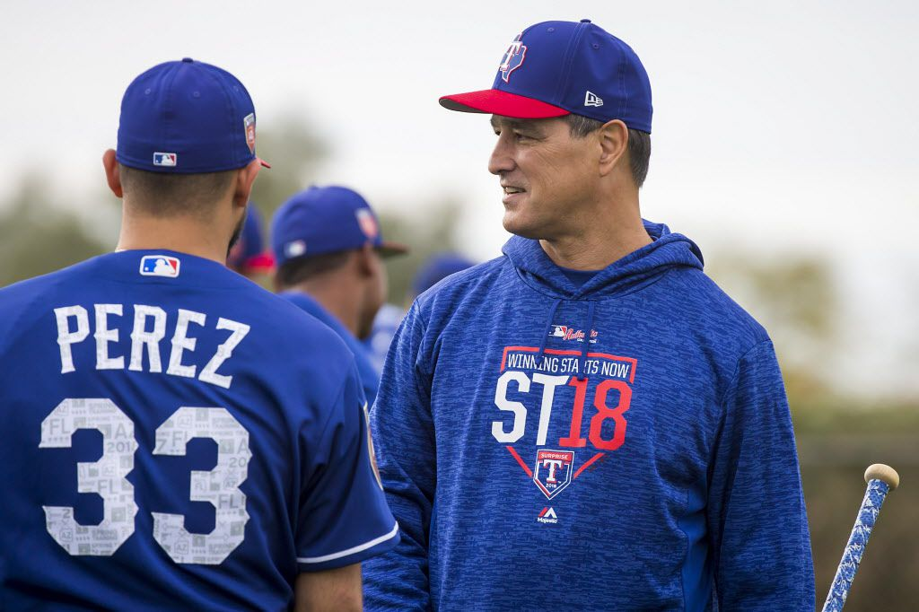 Texas Rangers bench coach Don Wakamatsu talks with pitcher Martin Perez during a spring training workout at the team's training facility on Friday, Feb. 16, 2018, in Surprise, Ariz. (Smiley N. Pool/The Dallas Morning News)