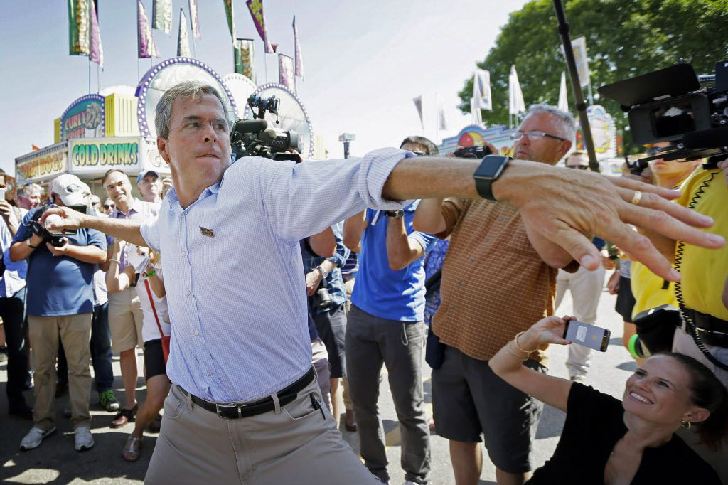 Republican presidential candidate, former Florida Gov. Jeb Bush, throws a baseball on the midway during a visit to the Iowa State Fair.
