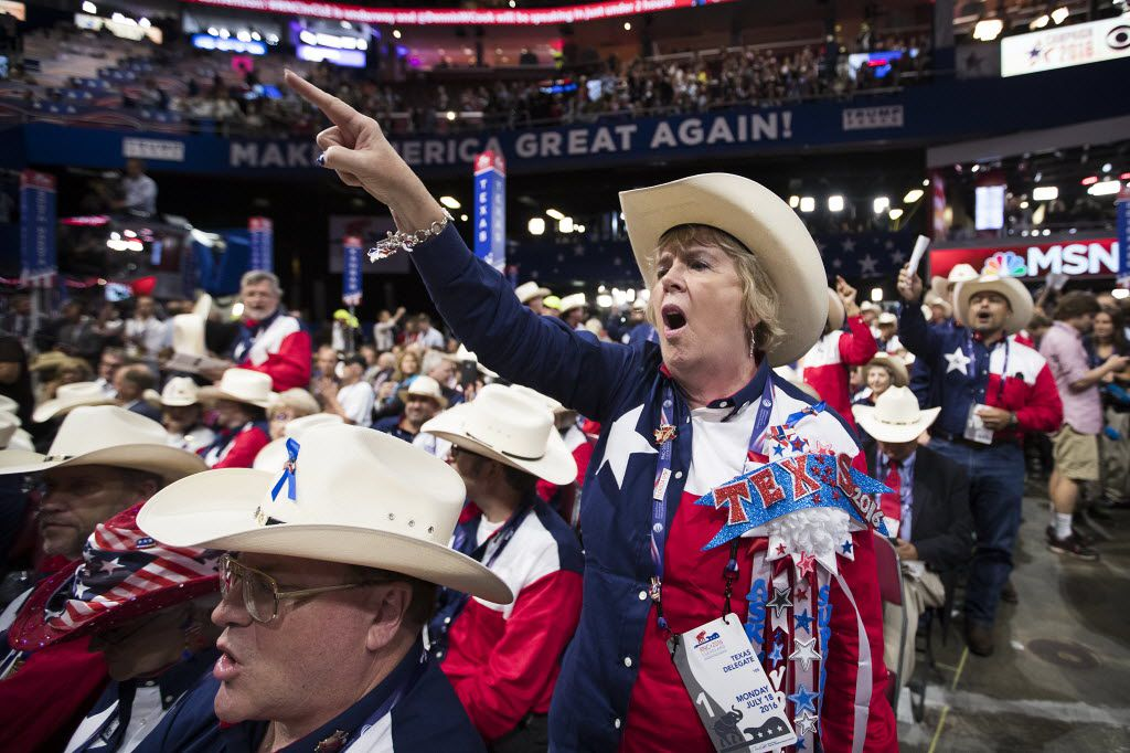 """Texas delegate Alice Rekeweg of Houston chants """"roll call vote"""" on the floor of the Republican National Convention on Monday in Cleveland. An effort by anti-Trump delegates to force a roll-call vote on convention rules failed during the opening session of the convention.  (Smiley N. Pool/The Dallas Morning News)"""