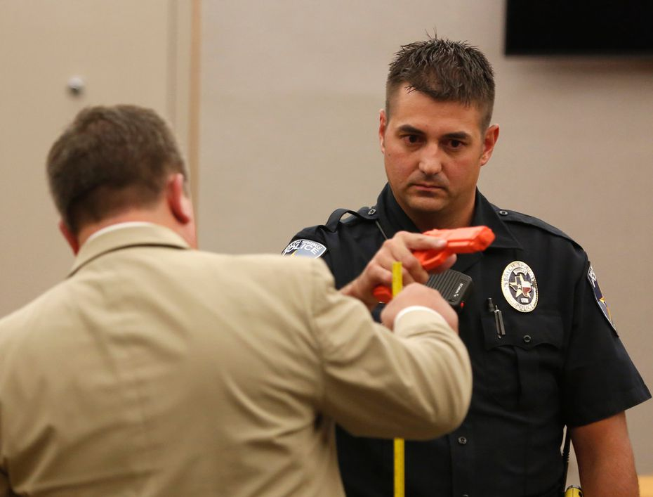 Defense attorney Miles Brissette (left) questions Balch Springs police officer Tyler Gross.