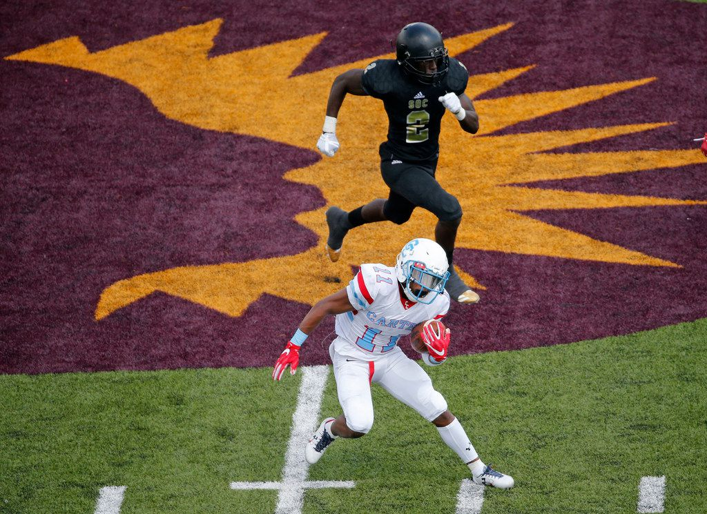 Carter's Marquis Borner (11) is chased by SOC's Kanion Williams (2) during the Carter High School Cowboys vs. the South Oak Cliff Golden Bears high school football game at Kincaide Stadium Stadium in Dallas on Saturday, September 23, 2017. (Louis DeLuca/The Dallas Morning News)