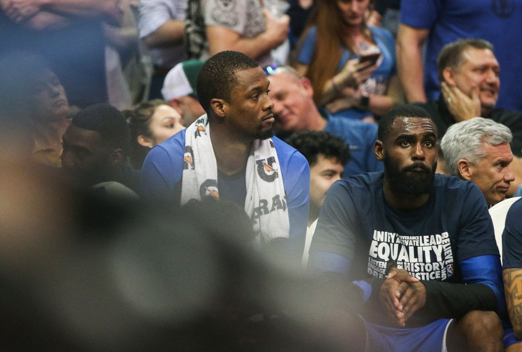 Dallas Mavericks forward Harrison Barnes (40), who was traded during the game, sits next to guard Tim Hardaway Jr. (11) during the second half a matchup between the Dallas Mavericks and the Charolette Hornets on Wednesday, Feb. 6, 2019 at the American Airlines Center in Dallas. (Ryan Michalesko/The Dallas Morning News)