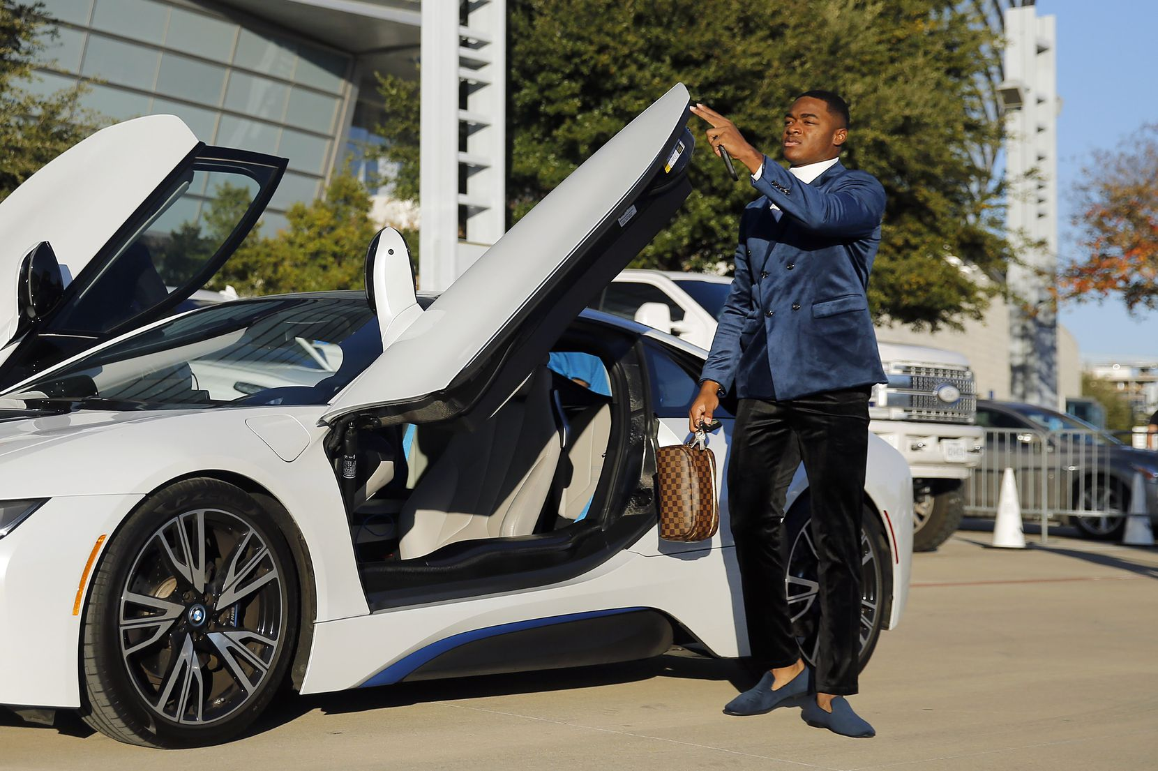Dallas Cowboys wide receiver Amari Cooper closes the door on his BMW i8 as he arrives to AT&T Stadium in Arlington, Texas for their game against the New Orleans Saints, Thursday, November 29, 2018. (Tom Fox/The Dallas Morning News)