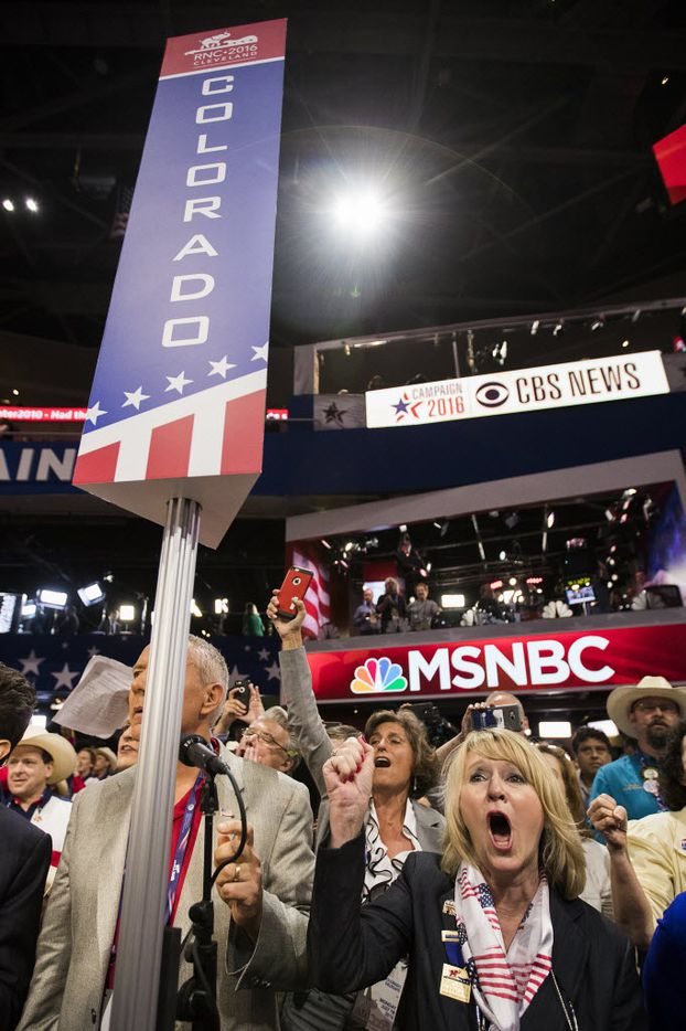 """Colorado delegates chant """"Roll Call Vote"""" on the floor of the Republican National Convention on Monday, July 18, 2016, in Cleveland. An effort by anti-Trump delegates to force a roll-call vote on convention rules failed during the opening session of the convention.  (Smiley N. Pool/The Dallas Morning News)"""