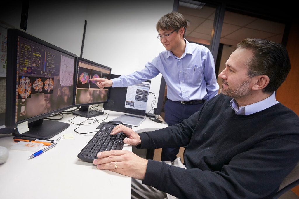 Dan Krawczyk, scientist and deputy director of the UT-Dallas Center for BrainHealth (right) and Kihwan Han, research scientist, tracking changes in injured brains after cognitive training.