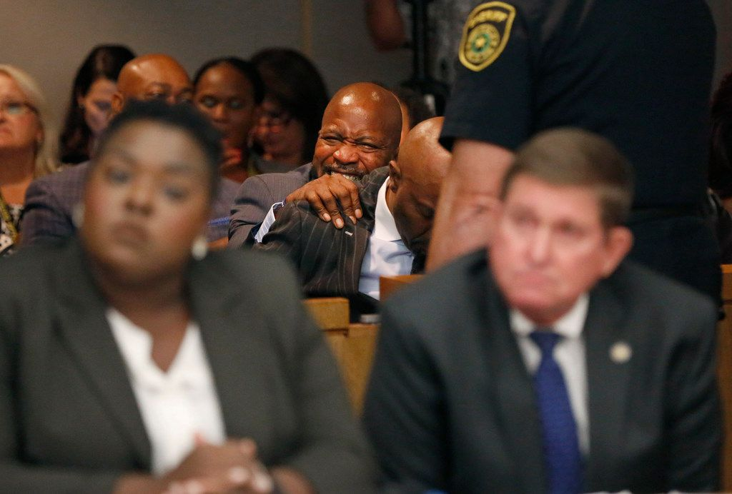 People in the courtroom react to a guilty verdict during the ninth day of the trial of fired Balch Springs police officer Roy Oliver, who was charged with the murder of 15-year-old Jordan Edwards, at the Frank Crowley Courts Building in Dallas on Tuesday.