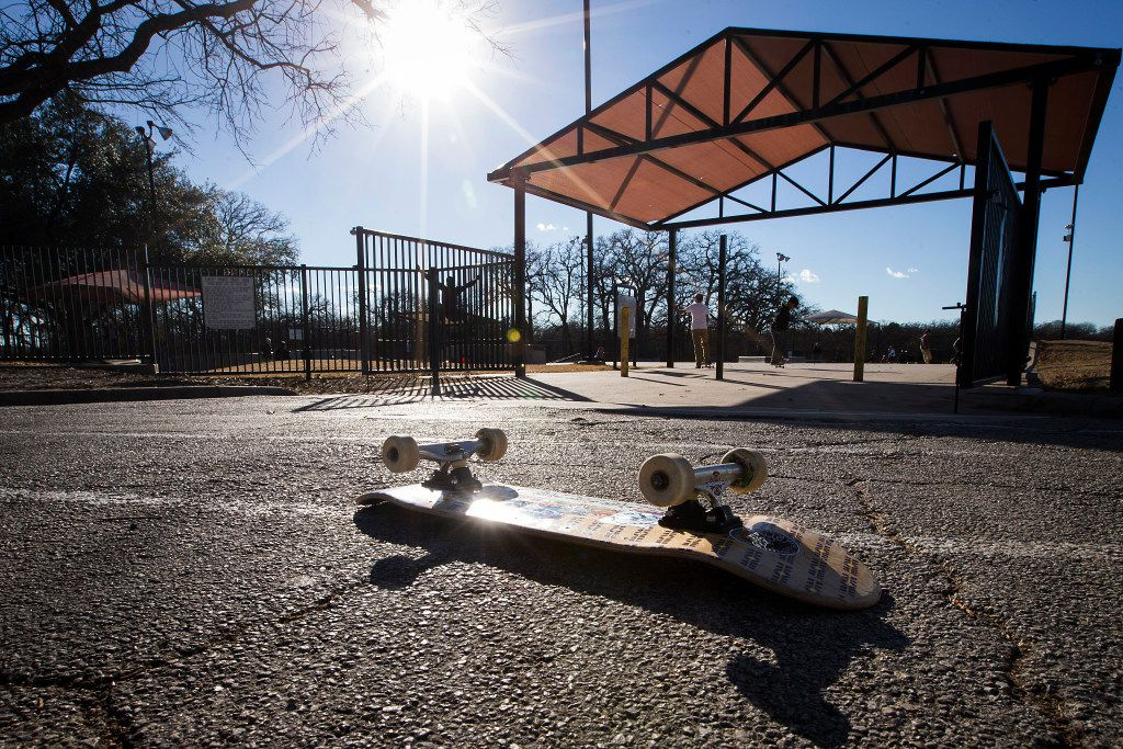 A skateboard rests in the parking lot at Lively Pointe Skate Park on Sunday, Jan. 22, 2017, in Irving. (Smiley N. Pool/The Dallas Morning News)