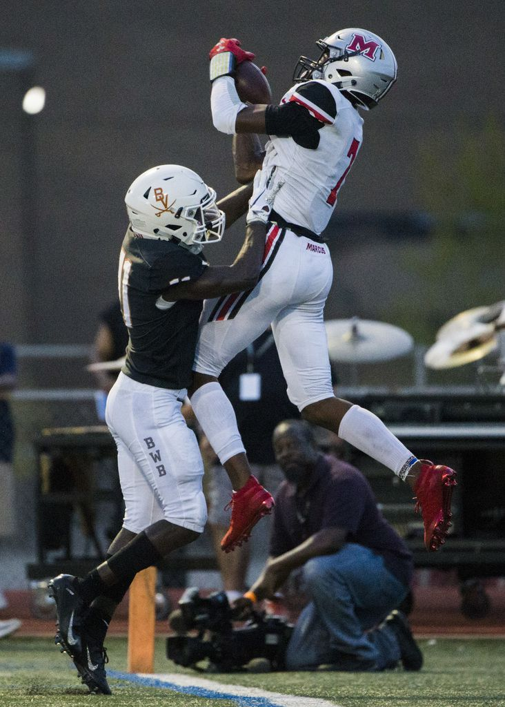 Arlington Bowie defensive back Jalen Curvin (11) pushes Flower Mound Marcus wide receiver J. Michael Sturdivant (7) out of bounds as he catches a pass in the back of the end zone during the second quarter of a high school football game between Flower Mound Marcus and Arlington Bowie on Thursday, August 29, 2019 at Wilemon Field in Arlington. (Ashley Landis/The Dallas Morning News)
