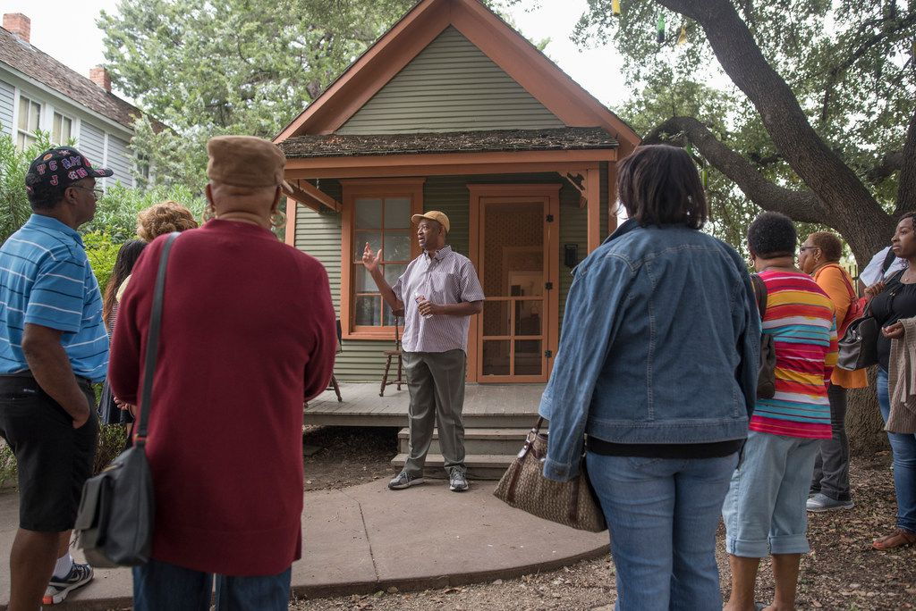 George Keaton Jr., founder and executive director of Remembering Black Dallas, center, gives a tour of a shotgun house at Dallas Heritage Village on Saturday, Oct. 7, 2017.  It was the first stop on a bus tour to areas that were once owned by former slaves and current and former African-American Communities of the North Dallas.