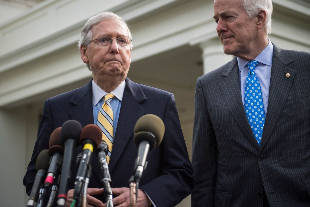 Senate Majority Leader Mitch McConnell, left, and Senate Majority Whip Sen. John Cornyn of Texas, speak with reporters at the White House after a meeting with President Trump.